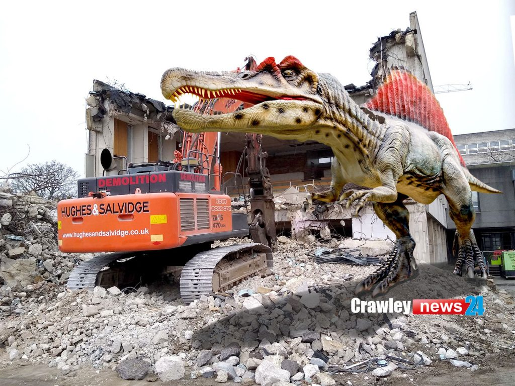 Spinosaurus next to the demolish of Crawley's Civic Hall
