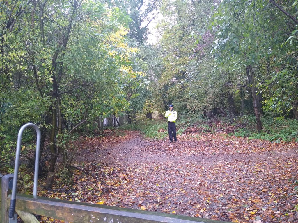 Police cordon around area where a mans body was found off Marion Road, Crawley